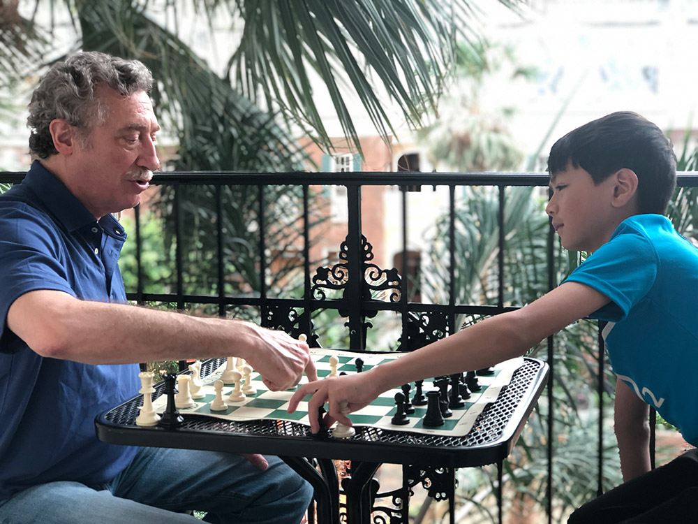 Oliver and his chess coach NM Bruce Pandolfini prepare before the next round of competition at the 2019 National Elementary (K-6) Championship in Nashville. May, 2019