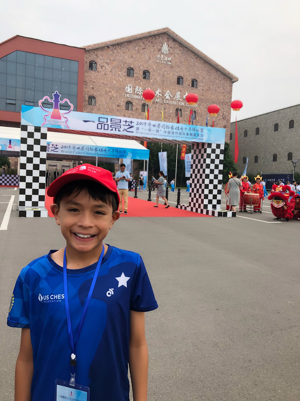 Oliver gets ready to enter the venue for the World Cadet Chess Championship in Weifang, China. August, 2019