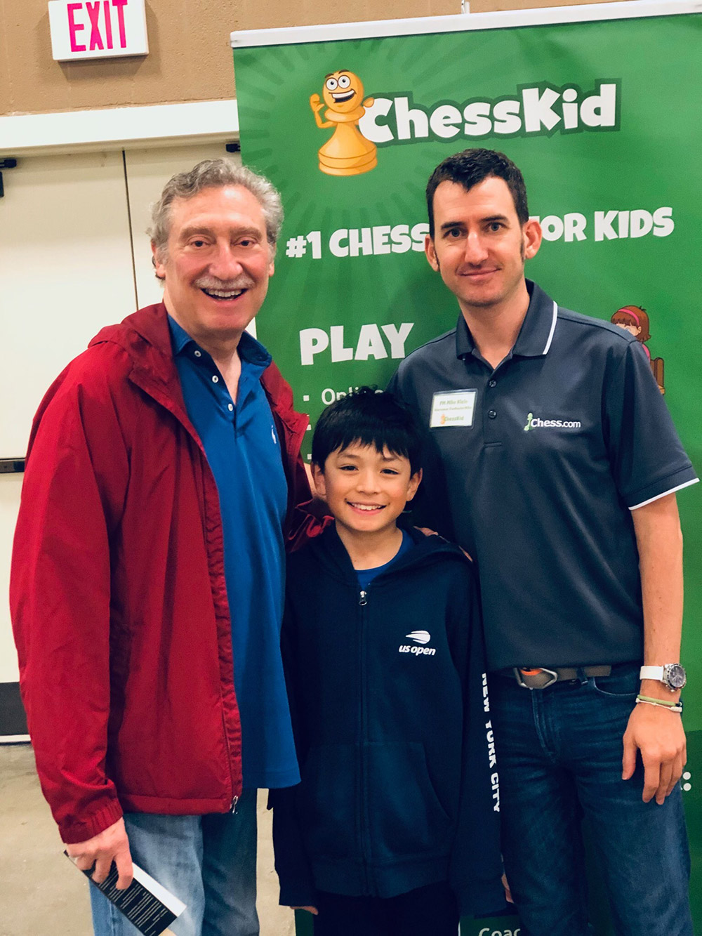 Oliver takes a break between chess rounds, with NM Bruce Pandolfini (left) and FM Mike Klein (right) at the 2019 National Elementary (K-6) Championships, held at the Gaylord Opryland Resort and Convention Center in Nashville. May, 2019