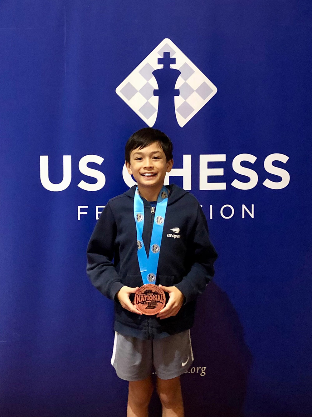 Oliver receives a medal at the 2019 National K-12 Grade Championships in Orlando. December, 2019