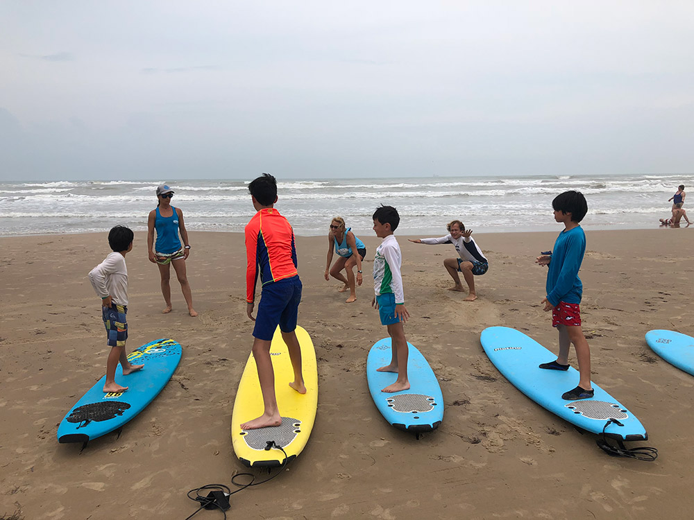 Surf's up! Oliver (3rd from left) takes a surf lesson on South Padre Island in Texas with his older brother, Sebastien, and his cousins, Reagan and Robbie. June, 2018