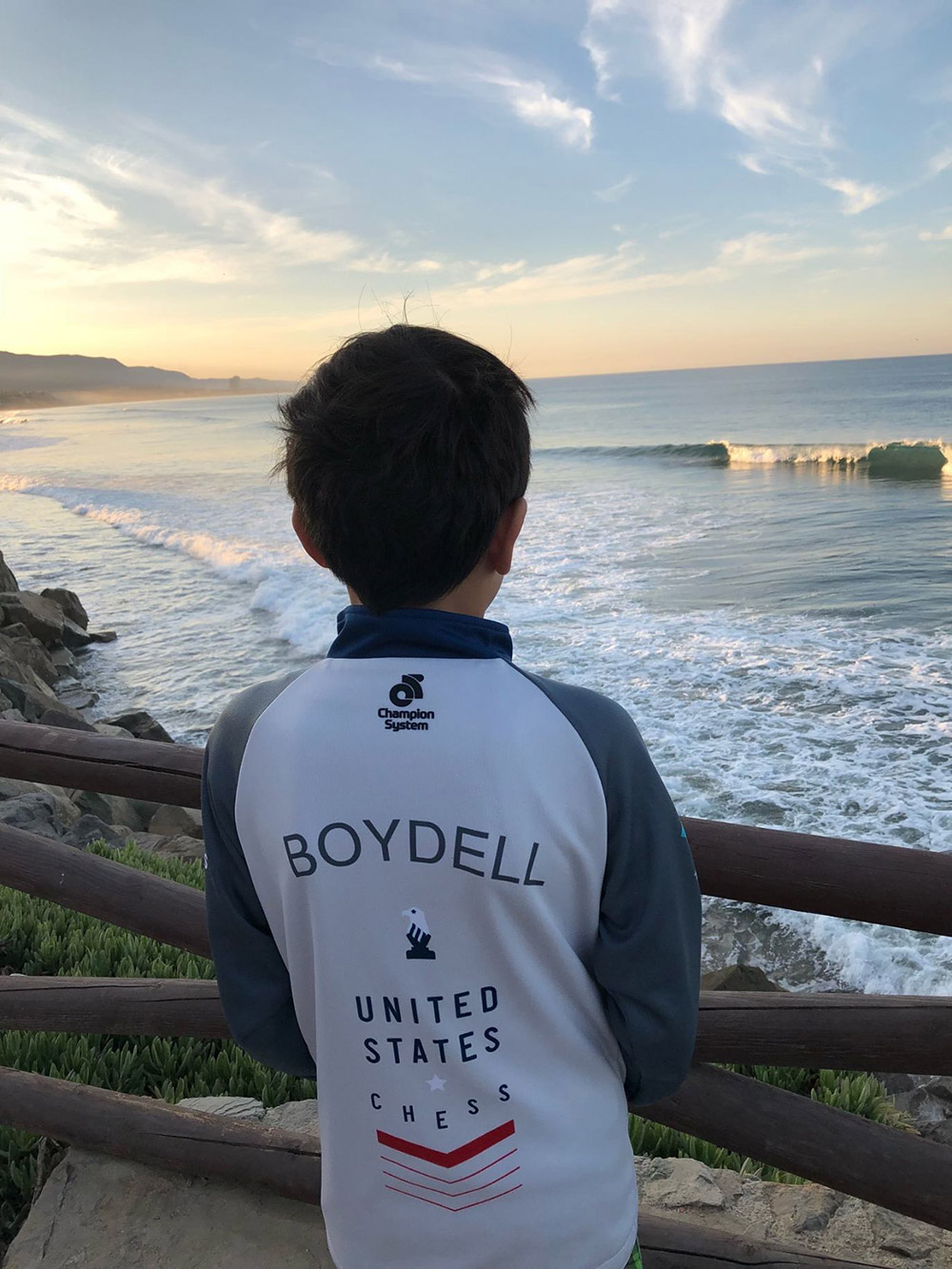 Oliver takes in the Pacific Ocean during a break from competition at the North American Youth Chess Championships in Mexico. November, 2018