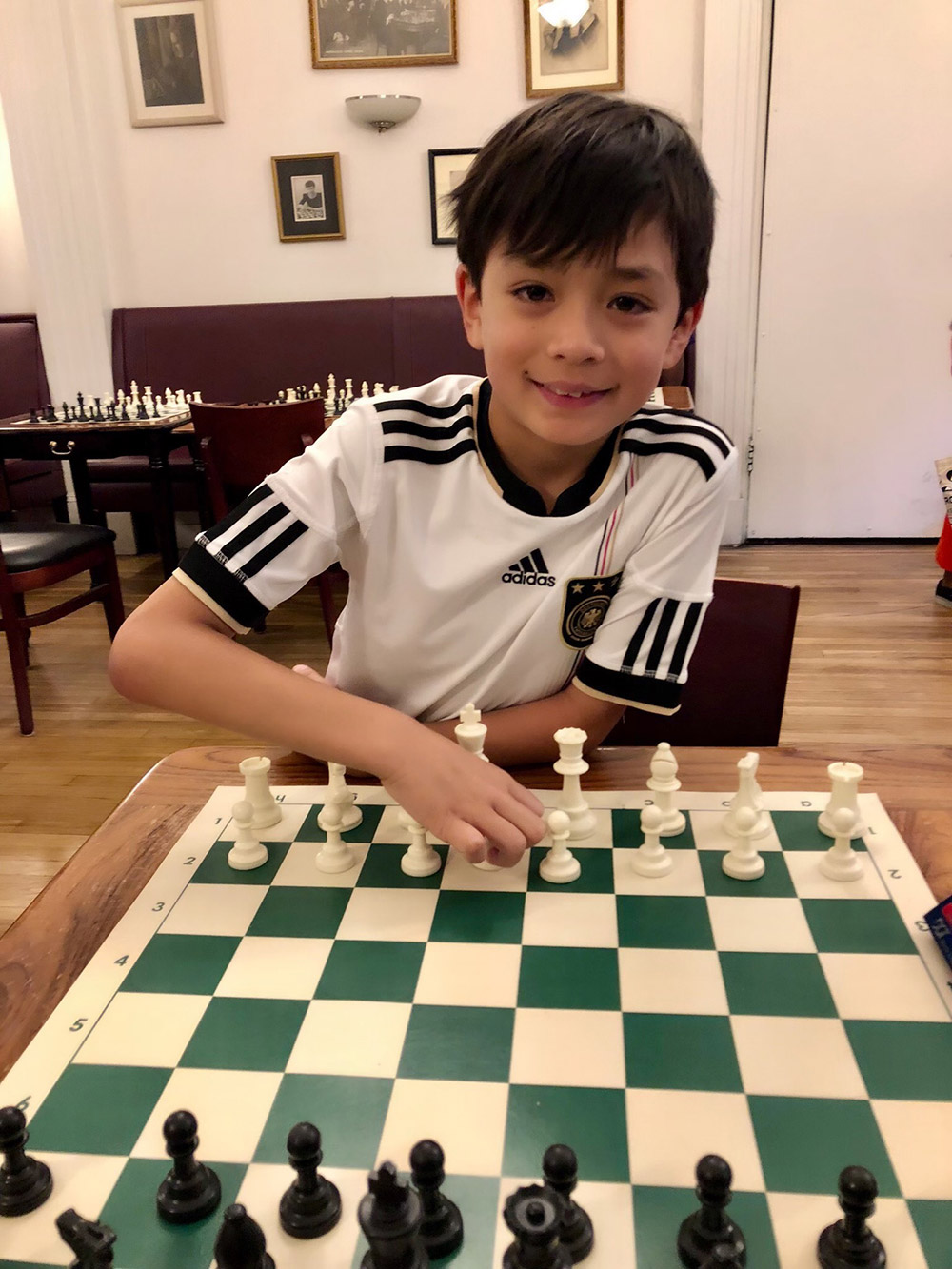 Oliver gets ready for some chess at the legendary Marshall Chess Club in New York City's Greenwich Village. May, 2018