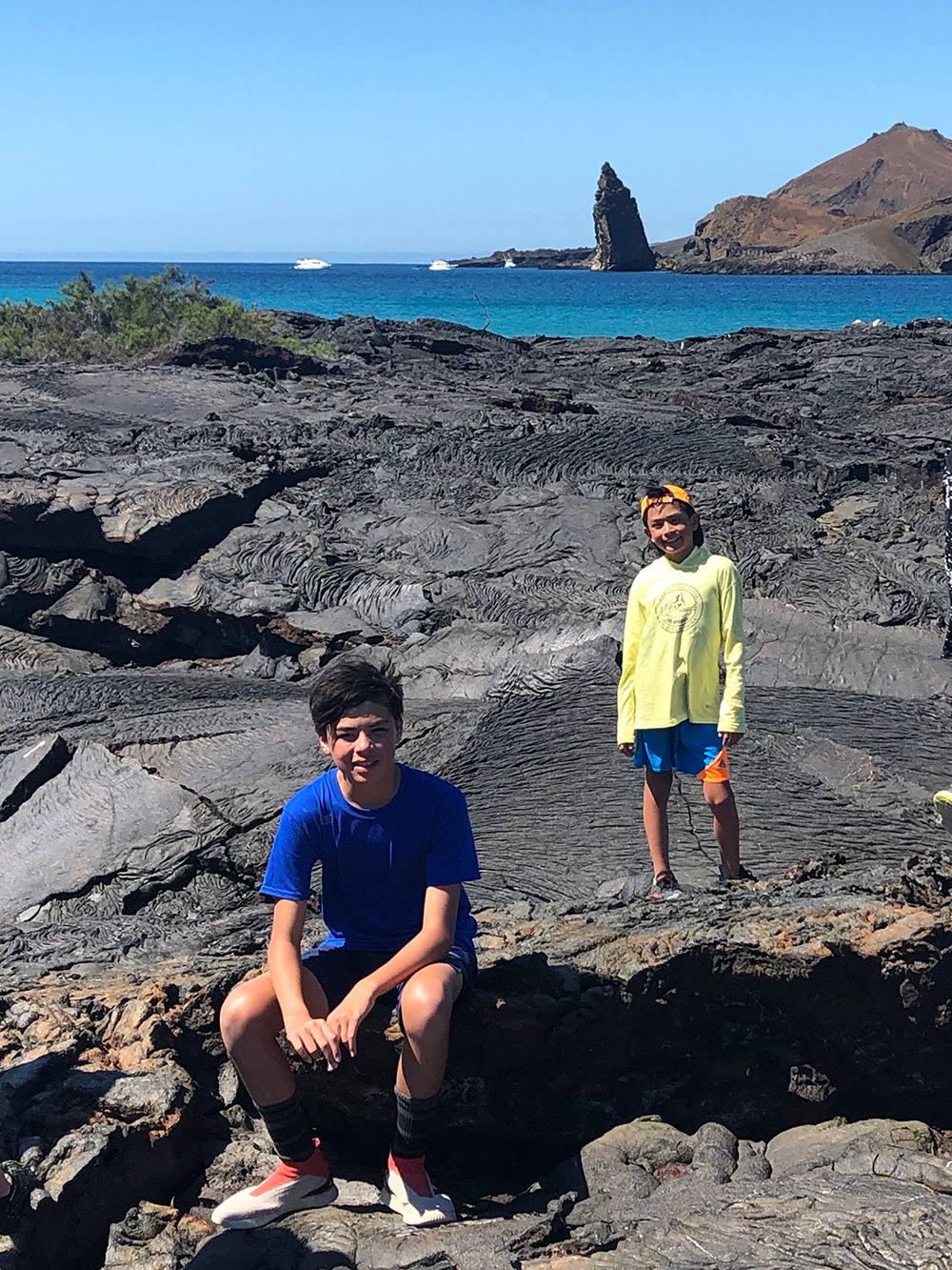 Oliver and his big brother Sebastien go for a hike on Santa Cruz Island, which was full of black rocks. July, 2019