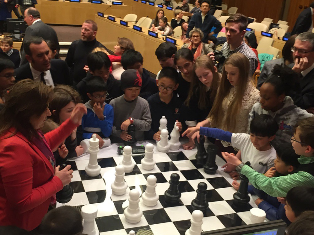 Oliver plays chess against GM Judit Polgar (Oliver is in white directly across from Judit) at the Global Chess Festival at the United Nations in NYC. March, 2017